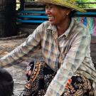 Cambodian pig farmer with sow